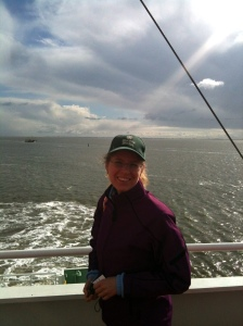 Maike on the Ferry with storms in the background.